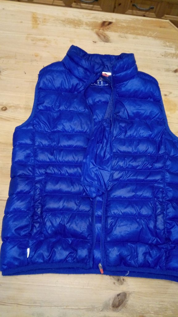 Blue sleeveless jacket, size small, feather filling, left behind Friday 24Nov2017. Contact Shirley Moore: 087 2307450